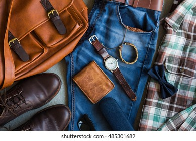 Flat lay of men's casual outfits with accessories on gray background
