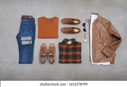 flat lay ,men's fashion, casual outfits with accessories on gray background