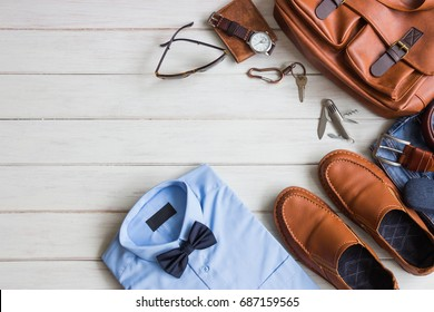 Flat lay, Men's fashion casual outfits and accessories with space on white wooden background