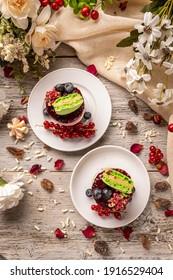Flat lay of mini round cheesecake decorated with half macaron