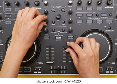 Flat lay of mixing board. Close-up shot of woman hands using musical device, touching buttons