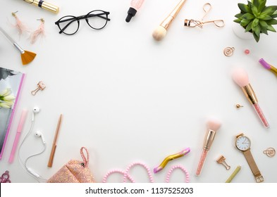 flat lay mockup frame composition with cosmetics, makeup tools, on white background pink colors. beauty, fashion, party and shopping concept. Copy space for lettering or text, blog background.