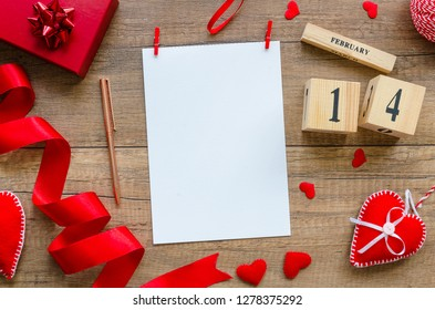 Flat lay mockup template blank paper for greeting card for Valentine's Day Holiday layout with symbols of love, hearts and perpetual calendar with the date of February 14, Top view