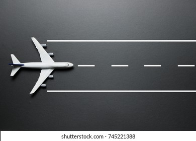 Flat lay of a model airplane on a runway