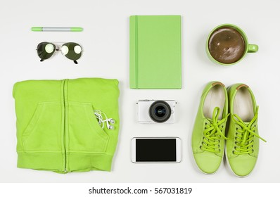 Flat Lay of Modern Green Hipster Accessories. Overhead Top View Photography. Youth Lifestyle Concept. Greenery Color of the Year 2017.