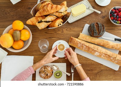 Flat Lay: mother and daughter having french breakfast