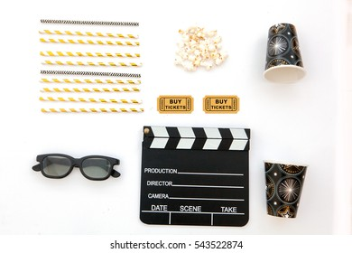 flat lay. movie/film concept.Pop corns, straw, tickets and clapperboard