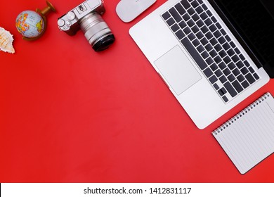flat lay Office desk table of modern workplace with laptop on red table, top view laptop background and copy space on red background, red desk office with laptop, Summer concept on red blackground