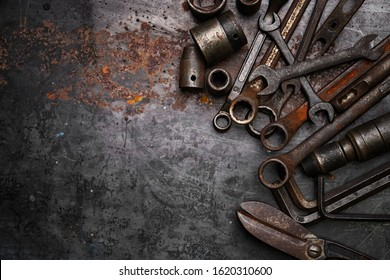 Flat lay Old hand tools ,Pliers screwdriver wrench rusted iron metal tools on Steel plate at garage
