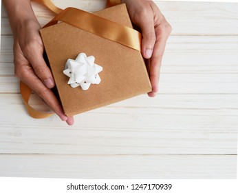 Flat lay on copy space of gift box in hand