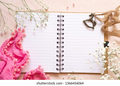 Flat lay: open notepad, white flowers and vintage decoration in the form of a horse (children's swing). Female diary. Maternal diary. Concept: childhood memories or childhood dreams