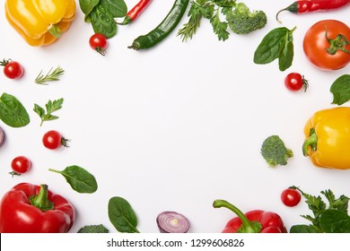 Flat lay with organic vegetables on white background