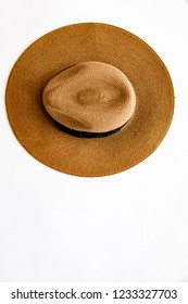 Flat lay over panama hat on white composition space background