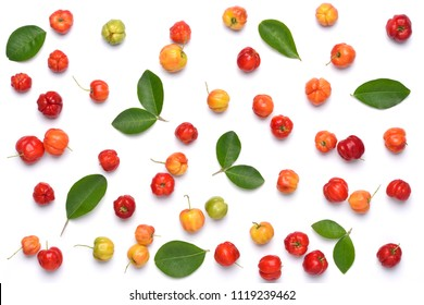 Flat lay pattern of fresh Acerola cherry with green leaves on white background, Top view