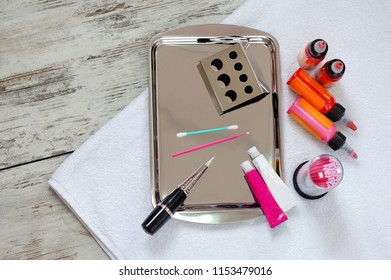 Flat lay of permanent makeup tools and pigments