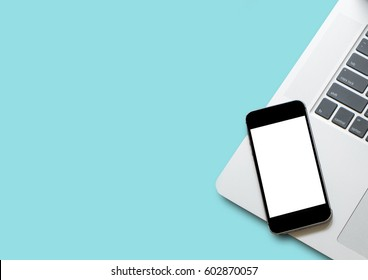 Flat lay phone white screen on top view,background in pastel colors.clipping path inside