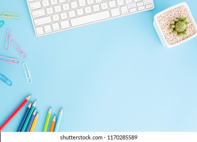 Flat lay photo of office desk with pencil and keyboard ,Top view workpace on blue background and copy space