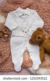 Flat lay photography of boy's smart outfits on soft pink wrap