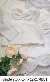 Flat lay photography of girl's smart outfits on creamy background