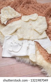 Flat lay photography of girl's smart outfits on soft pink wrap