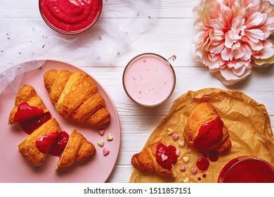 Flat lay picture of sweet croissants breakfast with strawberry jam