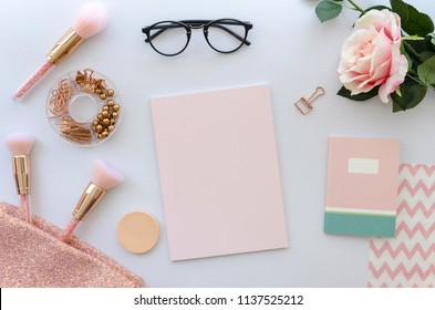 flat lay pink composition with blank note cosmetics, makeup tools, glasses and rose on white background. beauty, fashion, party and shopping concept. Copy space for lettering or text. Blog background.
