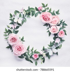 Flat lay pink rose flowers round frame