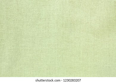 Flat lay of plain green woven fabric shot from above.