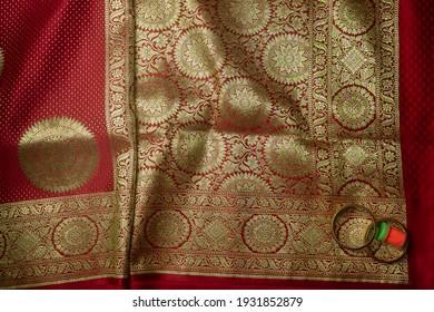 flat lay red golden silk saree