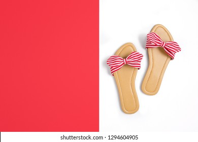 Flat lay red stripy sandals with copy space for text fashion lifestyle background image.
