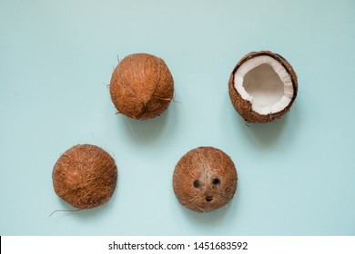 Flat lay with ripe coconuts on blue background. Top View. Copy Space. Pop art design, creative summer concept. Banner. Half of coconut in minimal flat lay style