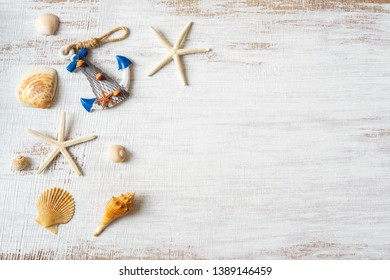 Flat lay of sea shells and starfish on grunge white wooden background. Background concept for Summer time holiday vacation. Sea holiday background. Nautical background.