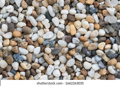 Flat lay of sea stones texture background. Abstract shape pattern from nature.