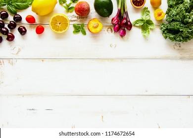 Flat lay of seasonal fruit, vegetables and greens. Summer food concept. Healthy life and vegetarian, vegan, dieting, clean eating ingredients
