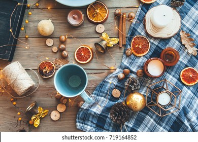 Flat lay of seasonal home craft decor. Coffee or tea break for home relax. Winter or autumn concept, warm homely scene.