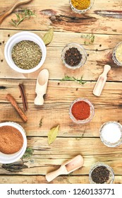 Flat lay of Seasoning background. Spice and herb seasoning with fresh and dried herbs and spices in bowls. Colourful various herbs and spices for cooking on wooden rustic background. Top view.