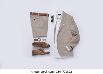 Flat lay set of classic men`s fashion clothes and accessories .