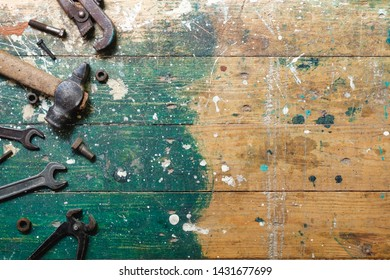 Flat lay set of vintage carpentry tools on colorful wooden background. Top view workbench with carpenter different tools. DIY, woodworking, craftsmanship and handwork concept