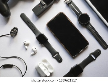 Flat lay shot of gadgets and mobile devices in white background.  - Shutterstock ID 1839621517