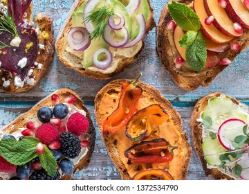 Flat lay of small open faced sandwiches with a variety of nutritious toppings ready for eating