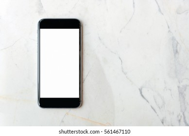 Flat lay Smartphone with blank white screen and copy-space on marble table. Elegant Design with Space for placement your background,Template mock up for montage your design and products