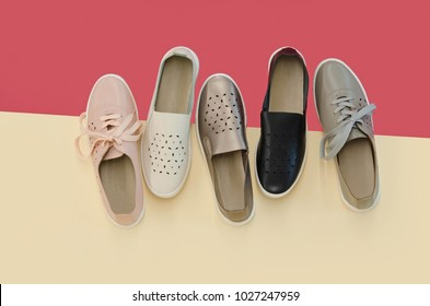 flat lay, sneakers shoes on colourful background.