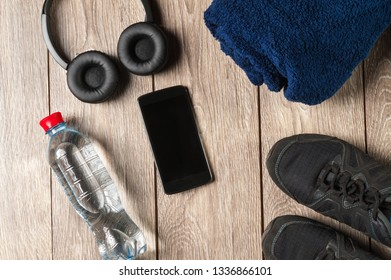 flat lay sport accessories water bottle with headphones