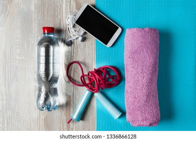 flat lay sport accessories water bottle with  jump rope