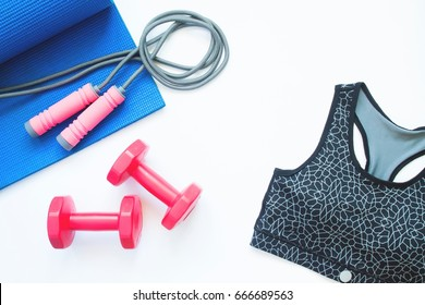 Flat lay of sport bra and sport equipments on white background, Healthy lifestyle, Gym and workout concept