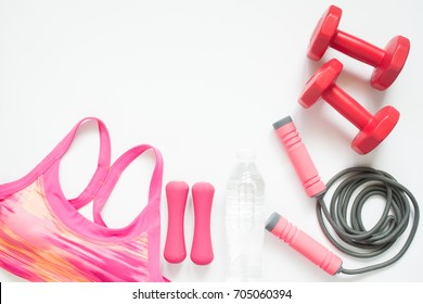 Flat lay of sport and workout equipments on white background