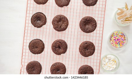 Flat lay. Step by step. Cooling freshly baked chocolate cupcakes on a cooling rack.