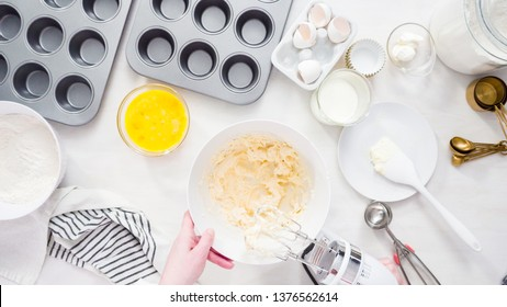Flat lay. Step by step. Mixing batter to bake vanilla cupcakes with buttercream frosting.