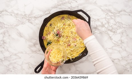 Flat lay. Step by step. Preparing spinach and ham frittata in cast iron skillet.