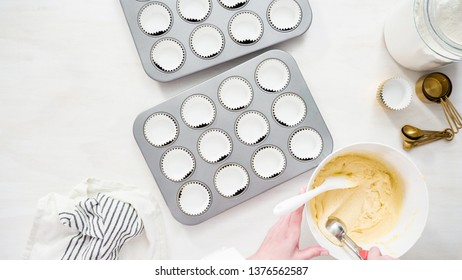 Flat lay. Step by step. Scooping cupcake batter into cupcake liners to bake vanilla cupcakes.